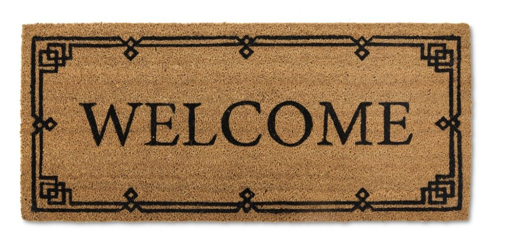 large doormat with the word welcome block text