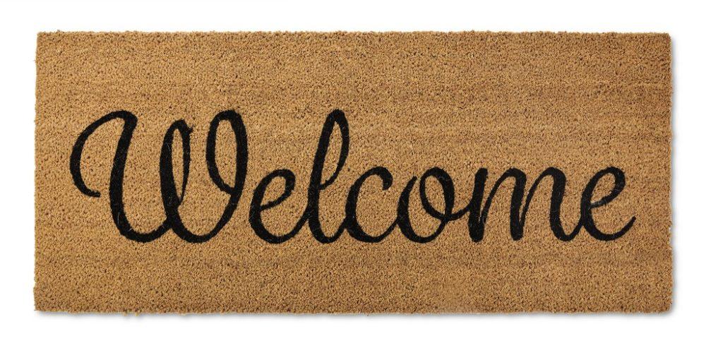 doormat with the word welcome script