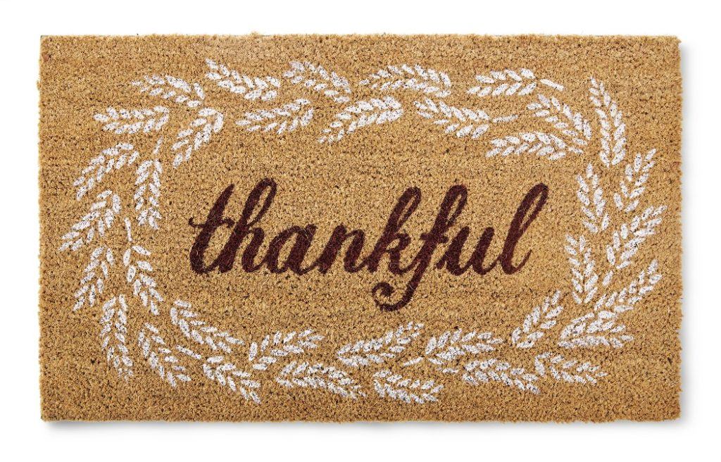 fall doormat with the word thankful